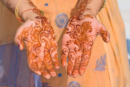 Henna on hands of bride from India photo