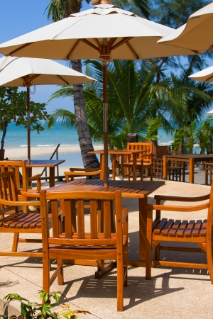 Table and chairs with a beautiful sea view on island Koh Samui, Thailand. photo