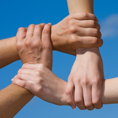 Couple hands connecting to a chain with blue sky Stock Photo - 17474095