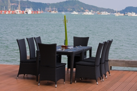 Table and chairs with a beautiful sea view on island Koh Phuket, Thailand. photo