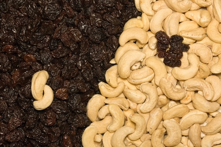 Yin and Yang symbol made of cashew and black raisins photo