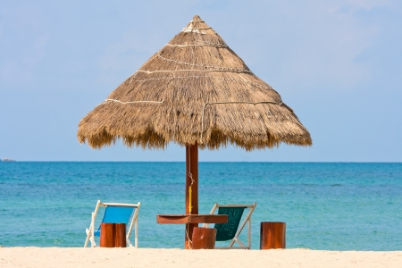 Beach umbrella and deck chairs on the beach. Island Koh Phangan,Thailand photo