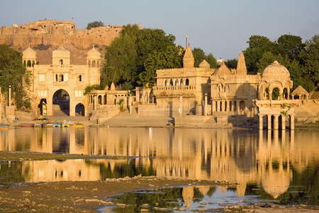Stone tower in sacred Gadi Sagar lake in Jaisalmer, India