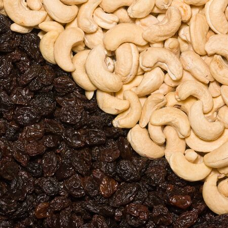 Background of cashew nut and black raisins photo