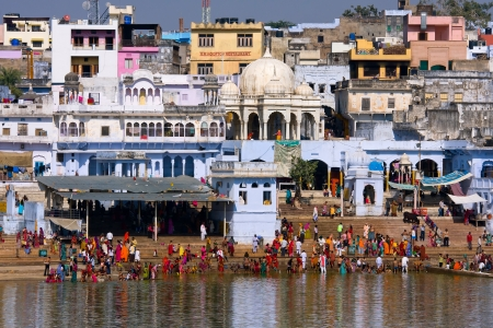 PUSHKAR, INDIA - NOVEMBER 18: people at ritual washing in the holy lake on November 18,2012 in Pushkar, India. A ritual bath in the lake is considered to lead one to salvation.