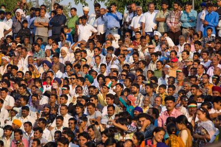 ATTARI, INDIA - OCTOBER 18: Indian celebrating at the Indian - Pakistani border during the border closing ceremony at October 18, 2012 in Attari, Punjab, India.