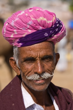 PUSHKAR, INDIA - NOVEMBER 18: An unidentified man attends the Pushkar Camel Mela on November 18, 2012 in Pushkar, Rajasthan, India. This fair is the largest camel trading fair in the world.