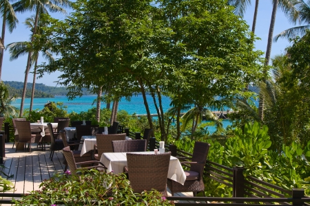 kood: Table and chairs with a beautiful sea view on island Koh Kood, Thailand. Stock Photo