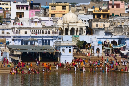 PUSHKAR, INDIA - NOVEMBER 18: people at ritual washing in the holy lake on November 18,2012 in Pushkar, India. A ritual bath in the lake is considered to lead one to salvation. Stock Photo - 18469095