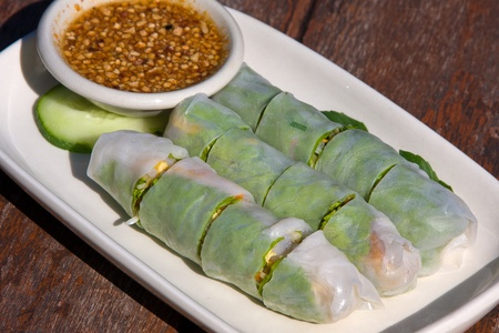 Chinese spring rolls with vegetable on the plate photo
