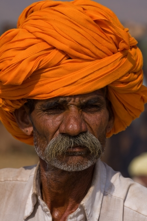 PUSHKAR, INDIA - NOVEMBER 19: An unidentified man attends the Pushkar Camel Mela on November 19, 2012 in Pushkar, Rajasthan, India. This fair is the largest camel trading fair in the world. Stock Photo - 20030480