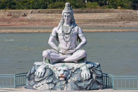 shiva: Statue Shiva, hindu idol on the river Ganges, Rishikesh , India