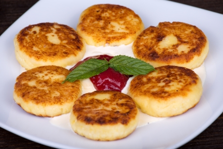 Delicious homemade cheese pancakes closeup photo