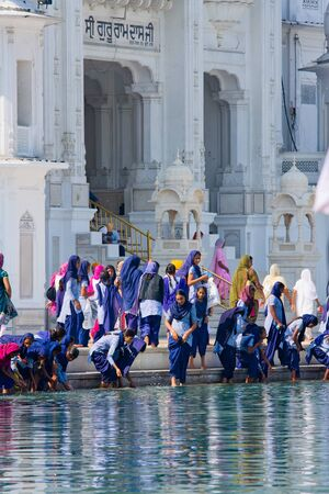 AMRITSAR, INDIA - OCTOBER 18: Sikh pilgrims in the Golden Temple during celebration day in October 18, 2012 in Amritsar, Punjab, India. Harmandir Sahib is the holiest pilgrim site for the Sikhs.