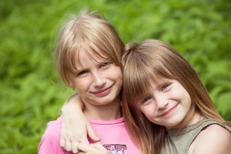 Close-up portrait of the two girl child photo