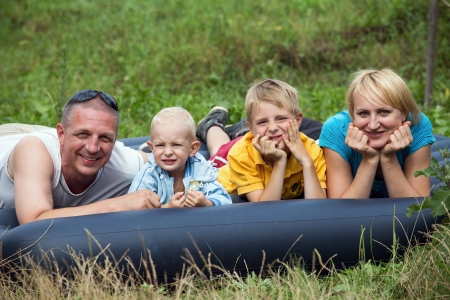 Happy mother, father and two sons in the park photo