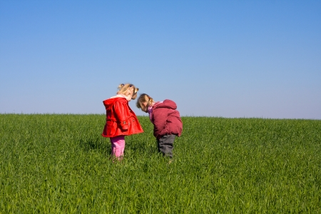 doublet:  Two girl child in nature Stock Photo