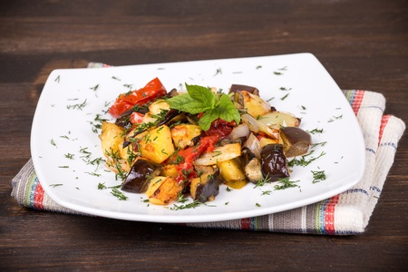 Traditional vegetable ratatouille on white plate photo