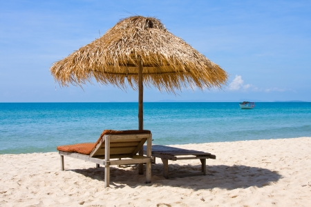 Beautiful tropical beach with deck chairs, Thailand photo