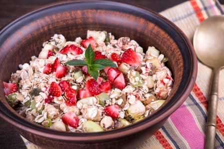 Delicious and healthy granola or muesli, with lots of dry fruits, nuts, berries and grains photo