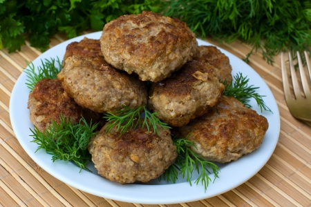 Fried cutlet with dill on a plate photo