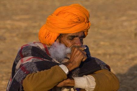 PUSHKAR, INDIA - NOVEMBER 23: An unidentified men attends the Pushkar Camel Mela on November 23, 2012 in Pushkar, Rajasthan, India. This fair is the largest camel trading fair in the world.