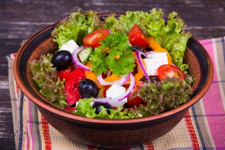 Fresh vegetable greek salad, close up photo