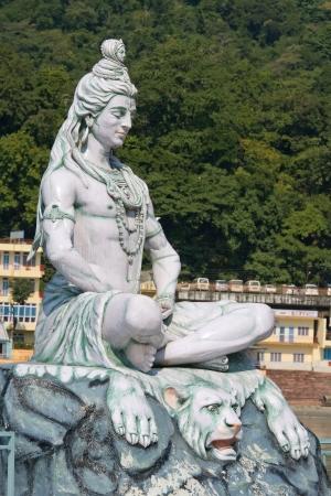Statue Shiva, hindu idol on the river Ganges, Rishikesh , India photo