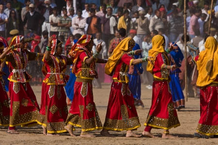 PUSHKAR, INDIA - NOVEMBER 21: An group of unidentified girls in colorful ethnic attire attends at the Pushkar fair on November 21, 2012 in Pushkar, Rajasthan, India.
