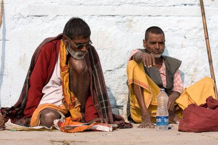 VARANASI, INDIA - DECEMBER 1: An unidentified sadhu sits on the ghat along the Ganges on December 1, 2012 in Varanasi, India. Tourism has drawn many alleged fake sadhus to Varanasi Stock Photo - 22450764