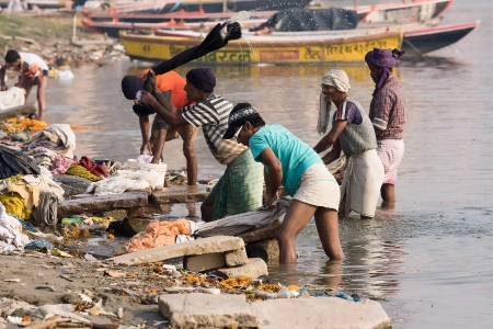VARANASI, INDIA - DECEMBER 1: Unidentified Indian people wash clothes in Ganga river on  December 1, 2012 in Varanasi, India. For many dwellers of Varanasi the Ganga is only way to wash clothes.