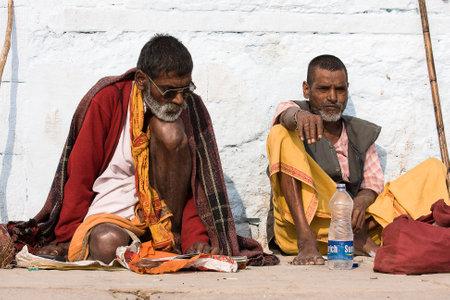VARANASI, INDIA - DECEMBER 1: An unidentified sadhu sits on the ghat along the Ganges on December 1, 2012 in Varanasi, India. Tourism has drawn many alleged fake sadhus to Varanasi Stock Photo - 22579425