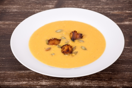 Apple pumpkin cream soup in a dish photo