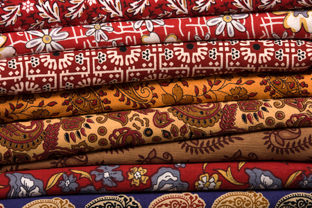 Heap of cloth fabrics at a local market in India. Close up . photo