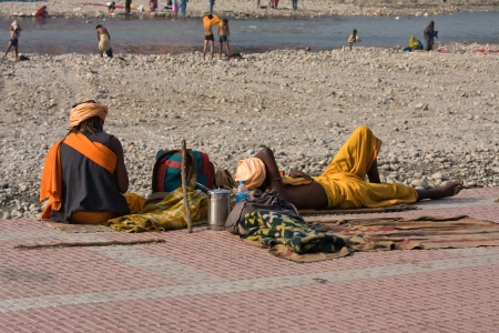 impoverished: HARIDWAR, INDIA - NOV 8: An unidentified homeless men sleeps on the sidewalk near the River Ganges on November 8, 2012 in Haridwar, India. Poor Indians flock to Haridwar for charity. Editorial