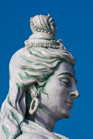 Statue Shiva, hindu idol on the river Ganges, Rishikesh , India photo