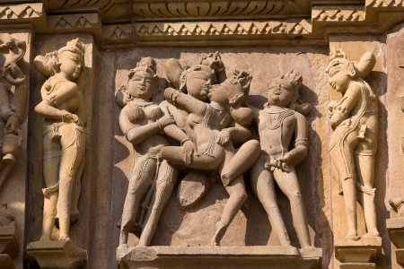 Stone carved - fragment of the famous erotic temple in Khajuraho, Madhya Pradesh State, India.  photo