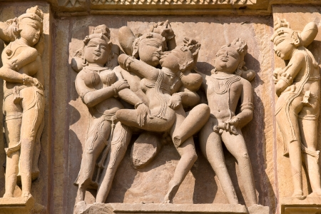 Stone carved - fragment of the famous erotic temple in Khajuraho, Madhya Pradesh State, India. Unesco World Heritage. photo