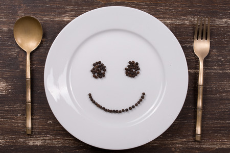 Happy smiley face on dish plate photo