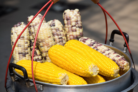 Streaming of corn in pot at outdoor marketplace. Thailand photo
