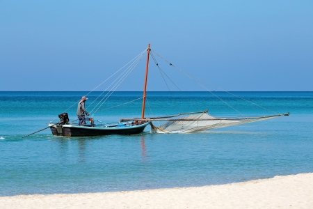 Traditional fishing in the sea. Island Koh Chang ,Thailand. photo