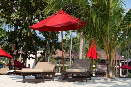phangan: Beach umbrella and deck chairs on the beach. Island Koh Chang, Thailand Stock Photo