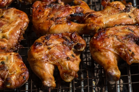 Grilled chicken legs are cooked in the restaurant photo