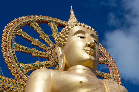 Statue of Buddha on blue sky background Koh Samui island, Thailand photo
