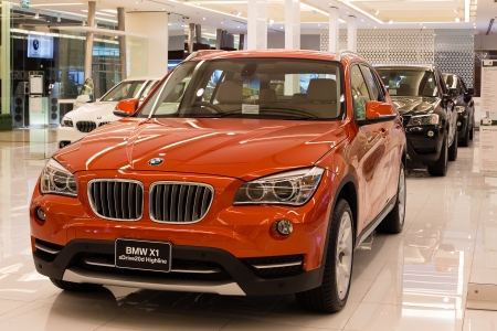 BANGKOK - NOVEMBER 19: BMW X1 xDrive 20d car on display at the Siam Paragon Mall on Nov 19, 2013 in Bangkok, Thailand. Siam Paragon is a one of the biggest shopping centres in Asia. Stock Photo - 24185926