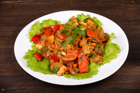 Vegetables with chicken in a curry sauce in white plate photo