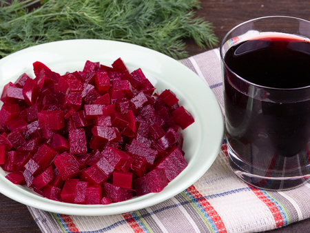 Fresh segments of a beet and beetroot juice photo