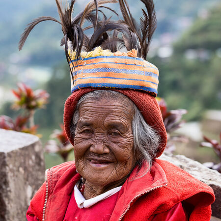 BANAUE - JANUARY 24   Unknown old ifugao woman in national dress next to rice terraces on January 24, 2014 in Banaue, Philippines  Ifugao - the people in the Philippines  Refers to the mountain peoples