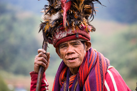 BANAUE - JANUARY 24   Unknown old ifugao man in national dress next to rice terraces on January 24, 2014 in Banaue, Philippines  Ifugao - the people in the Philippines  Refers to the mountain peoples