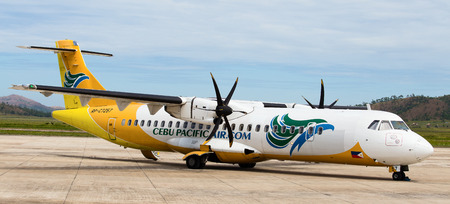 BUSUANGA, PHILIPPINES - FEBRUARY 08, 2014   Cebu Pacific airplane in Busuanga airport  Cebu Pacific Air is the largest carrier of passengers in the Philippines